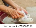 the hand washing a dirty white... | Shutterstock . vector #793002991