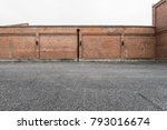 brick wall and asphalt parking... | Shutterstock . vector #793016674