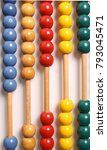 Small photo of Wooden vertical abacus on a white background