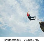 A Man Jumps Into A Canyon From...