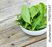 baby spinach in a white bowl on ... | Shutterstock . vector #793075147