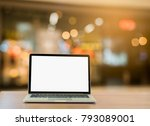 laptop on wood table blurred... | Shutterstock . vector #793089001