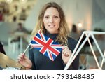 a young woman is holding a flag ... | Shutterstock . vector #793148485