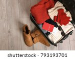 open suitcase with warm clothes ... | Shutterstock . vector #793193701