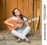 girl in summer with guitar... | Shutterstock . vector #793221985