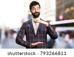 well dressed man holding... | Shutterstock . vector #793266811