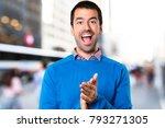handsome young man applauding... | Shutterstock . vector #793271305