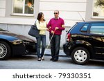 a young woman helps a man on... | Shutterstock . vector #79330351