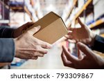 worker giving a package in... | Shutterstock . vector #793309867