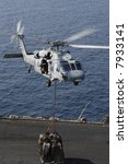 A Navy SH-60 Helicopter Performs Replenishment At Sea On the Nuclear Aircraft Carrier, USS Enterprise