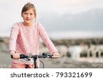 pretty kid girl riding bicycle... | Shutterstock . vector #793321699