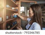 female artisan standing in her... | Shutterstock . vector #793346785