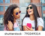 two laughing young girlfriends...   Shutterstock . vector #793349314