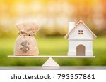 home and money bag put on the... | Shutterstock . vector #793357861