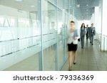 several businesspeople walking...   Shutterstock . vector #79336369