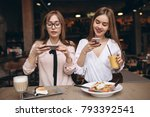 two girls having lunch in a... | Shutterstock . vector #793392541