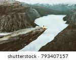 man traveler on trolltunga... | Shutterstock . vector #793407157