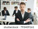serious young leader in suit... | Shutterstock . vector #793409161
