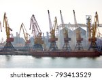 Port Cranes At Cloudy Sky....