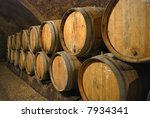 Old wine barrels in the cave of a wine castle - stock photo