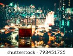 a glass with alcohol on a... | Shutterstock . vector #793451725