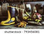 firefighter boots and fire hoses | Shutterstock . vector #793456081