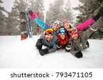 group of happy skiers lying on... | Shutterstock . vector #793471105