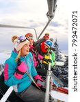 cheerful young friends skiers... | Shutterstock . vector #793472071