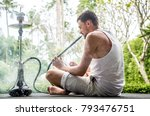 man smoking a hookah on... | Shutterstock . vector #793476751