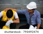 Cry Asian foreman get fired or unemployment while Senior engineer manager cheer up at construction site. bad economy crisis due to covid-19 or coronavirus disease. Work safe from home, quarantine. - stock photo