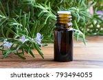 a dark bottle of rosemary... | Shutterstock . vector #793494055