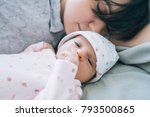 mom with pleasure sniffing her... | Shutterstock . vector #793500865