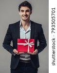 handsome yound man in suit is... | Shutterstock . vector #793505701