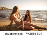 chilling on the sand  | Shutterstock . vector #793555804