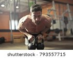 concentrated athlete at the gym    Shutterstock . vector #793557715