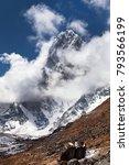 Small photo of Mount Arakam Tse and clouds near Cho La Pass, beautiful mount on the way to Everest base camp, three passes trek, Khumbu valley, Sagarmatha national park, Nepal
