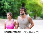couple running together in a... | Shutterstock . vector #793568974