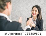 Small photo of Boss/Business man employer admires young Asian business woman/staff/employee by thumb up and clap with smiling face for her success and good/best in work and recognition/appreciate.