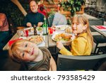 happy family eating hamburger... | Shutterstock . vector #793585429