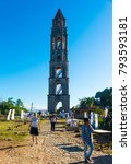 Small photo of Trinidad/Cuba- December 28, 2017: Iznaga tower general ambiance, street vendors selling weather appropriate clothing to tourists. The structure is a UNSCO site visited by many.