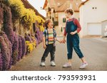 two cute happy young kids... | Shutterstock . vector #793593931