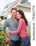 happy couple standing in front...   Shutterstock . vector #79361776
