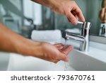 man washing hands in bathroom... | Shutterstock . vector #793670761