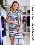 girl wearing striped dress ... | Shutterstock . vector #793675951