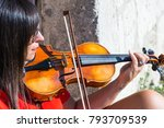 Woman Playing Violin In Studio...
