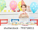 young boy holding box with... | Shutterstock . vector #793718011