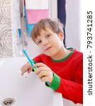 child boy brushing his teeth in ... | Shutterstock . vector #793741285