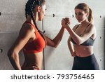 fit women holding hands with a... | Shutterstock . vector #793756465