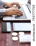 laptop with cash and bitcoin on ...   Shutterstock . vector #793777705