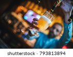 Stock photo barmen or brewer filling glass with beer barmen is pouring lager beer to glass from beer taps 793813894